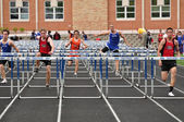 Teen Boys Competing in High School Hurdles Race — Stock Photo