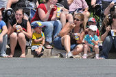 Family Eating Frozen Treats While Watching Parade — Stock Photo