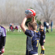 Player Preparing to Throw a  Overhead Pass for a Lineout in a Women - Lizenzfreies Foto