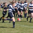 Player About to Kick the Ball in a Women's College Rugby Match — Stock Photo