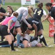 Player Being Tackled in a Women - ストック写真