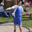 Teen Boy Throwing the Discus at a High School Track and Field Meet - ストック写真