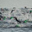 Start of a Men's Open Water Swim Race - Stock Photo