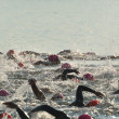 Women Competing in Open Water Swim Race - Stock Photo