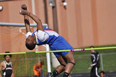 Teen Boy Doing the High Jump at a High School Track and Field Meet — Stock Photo