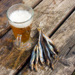 Beer and dried fishes — Stock Photo