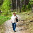 Middle-aged woman in autumn park — Stock Photo #8163060