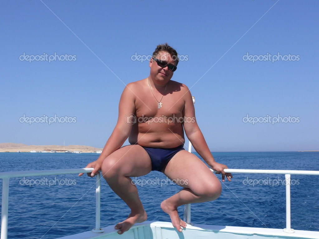  Image of a young masculine man posing at the sea                                 Stock Photo #8165410