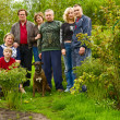 Family portrait and dog outdoors — Stock Photo #8613121