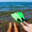 Royalty-Free Stock Photo: Two pairs of legs in sea water