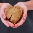 A guy with a heart in his hands — Stock Photo #8613299
