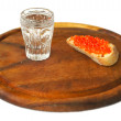 Sandwiches with red caviar and glass of vodka — Stock Photo