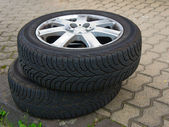 Two worn old tires with discs — Stock Photo