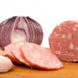 Sliced sausage with onion and garlic — Stock Photo #9582067