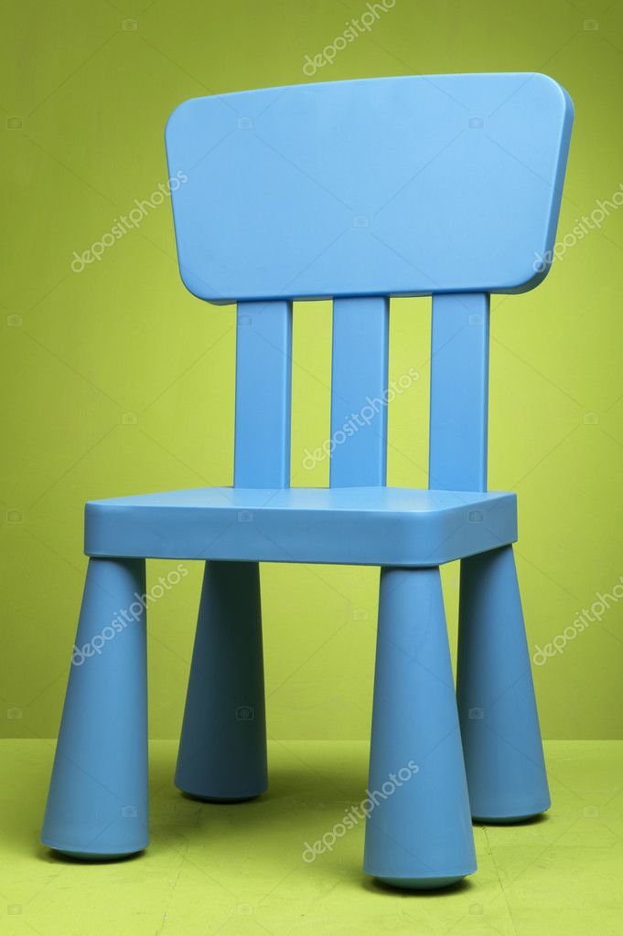 Kid blue chair in a studio set up — Zdjęcie stockowe #8346629