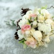 Wedding bouquet laying on ice - Stock Photo