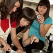 Friends cooking together — Stock Photo