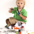 Boy with paints - Stock Photo