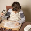 Girl making cookies - Stock Photo