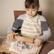 Girl making cookies - Stockfoto