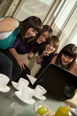 Friends looking at laptop — Stock Photo