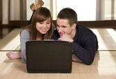 Young couple surfing the net — Stock Photo