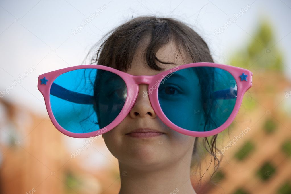 Girl with funnny big sunglasses — Stock Photo #8266442