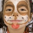 Young girl with a painted dog on her face — Stock Photo