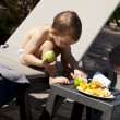 Boy with fruits — Stock Photo