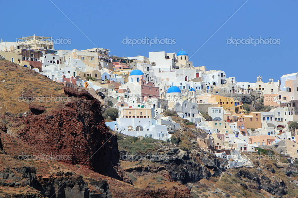 View on the caldera with the blue domes of orthodox churches in Oia, Santorini island, Greece  Stock Photo #10656969