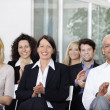 Business team applauding after a conference - Stock Photo