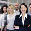 Mature businesswoman and business team — Stock Photo