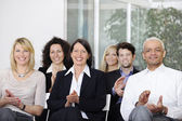 Business team applauding after a conference — Stock Photo