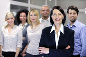 Mature businesswoman and business team — Foto Stock