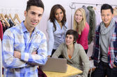Portrait of fashion designer team at work — Stock Photo