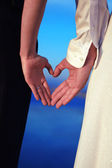 Couple With Hands Shaped like Hearts — Stock Photo