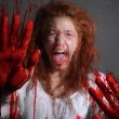 Horror Themed Image With Bleeding Freightened Woman — Stock Photo #9939356