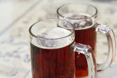 Two beer mugs closeup photo — Stock Photo