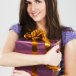 Young beautiful woman with a gift box — Stock Photo