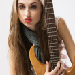 Stock Photo: Beautiful lady with electric guitar