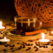Cup of coffee in natural candle light - Stock Photo