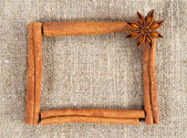 Cinnamon sticks frame on a sacking cloth — Stock Photo