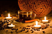 Cup of coffee in natural candle light — Stock Photo