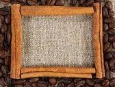 Cinnamon sticks frame on a sacking cloth — Stock Photo