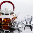 Teapot with cups — Stock Photo