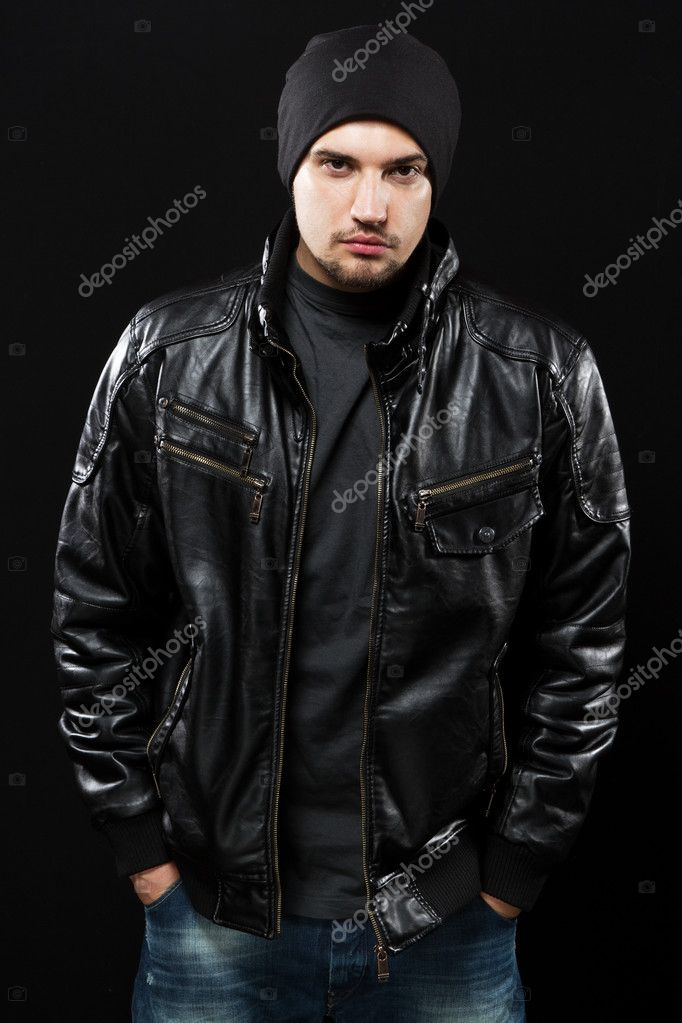Handsome young man in black leather jacket, studio portrait — Stock Photo #9280530
