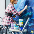 Painter at work, painting a home interior - Stock Photo