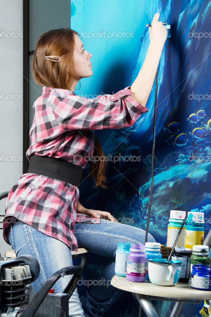 Professional painter at work, painting a home interior  Stock Photo #9652717