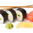 Three sushi, wasabi, gringer, lemon and sticks — Stock Photo