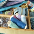 Blue sewing utensils in wooden box — Stock Photo